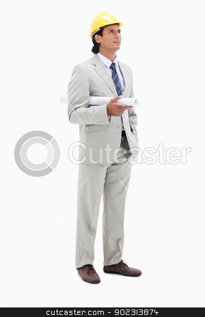 Architect with helm and construction plan stock photo, Architect with helm and construction plan against a white background by Wavebreak Media