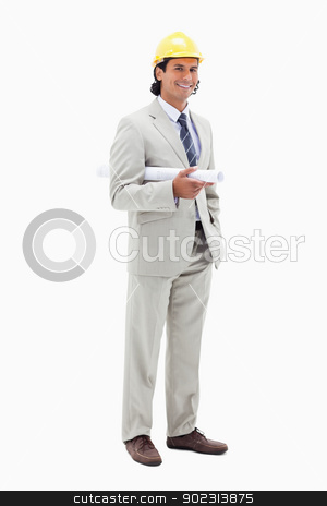 Smiling architect with helm and construction plan stock photo, Smiling architect with helm and construction plan against a white background by Wavebreak Media
