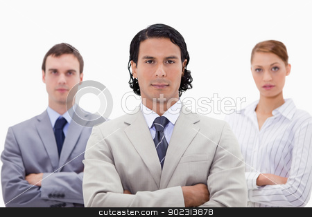 Three businesspeople with folded arms stock photo, Three businesspeople with folded arms against a white background by Wavebreak Media