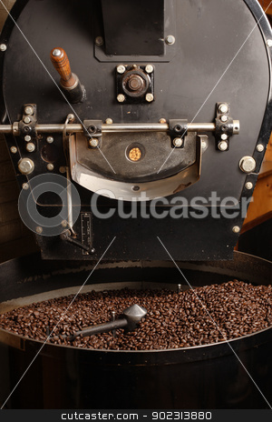 Roaster cooling coffee beans stock photo, The freshly roasted coffee beans from a large old coffee roaster being stirred in the cooling cylinder. by © Ron Sumners