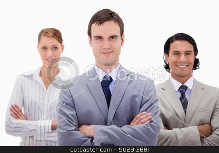 Smiling businesspeople with arms folded stock photo, Smiling businesspeople with arms folded against a white background by Wavebreak Media