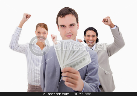 Successful businessman with cheering colleagues stock photo, Successful businessman with cheering colleagues against a white background by Wavebreak Media