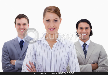 Smiling businessteam with arms folded stock photo, Smiling businessteam with arms folded against a white background by Wavebreak Media