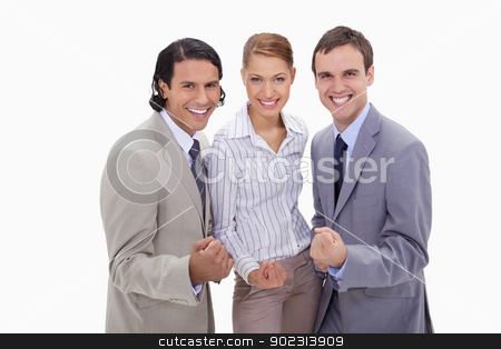 Successful businessteam standing together stock photo, Successful businessteam standing together against a white background by Wavebreak Media