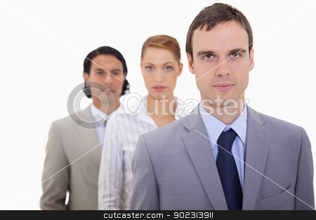 Serious businessteam lined up stock photo, Serious businessteam lined up against a white background by Wavebreak Media