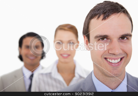 Smiling businesspartner lined up stock photo, Smiling businesspartner lined up against a white background by Wavebreak Media