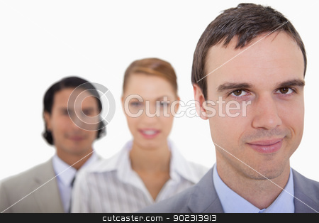 Businessteam standing in a row stock photo, Businessteam standing in a row against a white background by Wavebreak Media