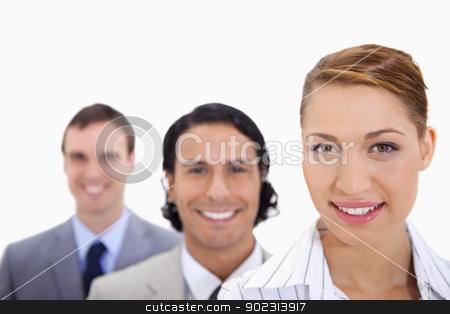 Smiling businessteam standing in line stock photo, Smiling businessteam standing in line by Wavebreak Media