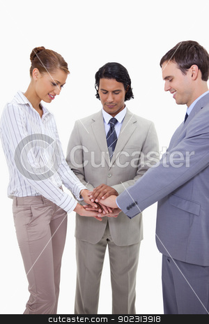 Businessteam cheering up stock photo, Businessteam cheering up against a white background by Wavebreak Media