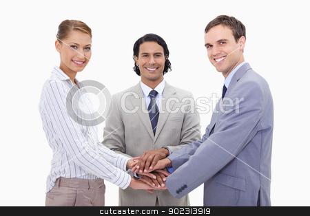 Businessteam motivating each other stock photo, Businessteam motivating each other against a white background by Wavebreak Media