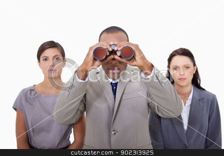Businessman with colleagues using binoculars stock photo, Businessman with colleagues using binoculars against a white background by Wavebreak Media