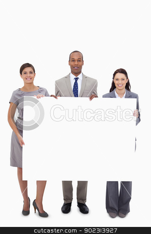 Businesspeople holding blank sign stock photo, Businesspeople holding blank sign against a white background by Wavebreak Media