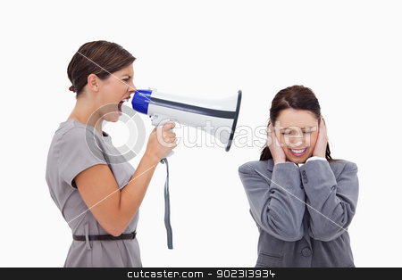 Businesswoman yelling at colleague with megaphone stock photo, Businesswoman yelling at colleague with megaphone against a white background by Wavebreak Media