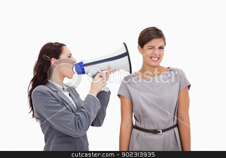 Businesswoman with megaphone yelling at colleague stock photo, Businesswoman with megaphone yelling at colleague against a white background by Wavebreak Media