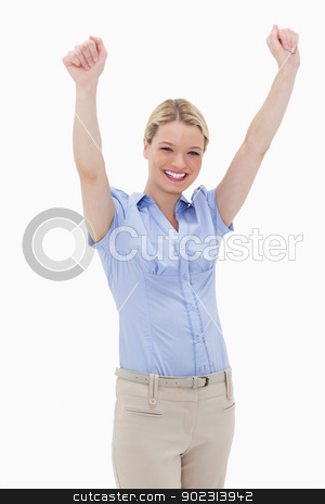 Happy cheering woman stock photo, Happy cheering woman against a white background by Wavebreak Media