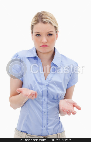 Clueless young woman stock photo, Clueless young woman against a white background by Wavebreak Media
