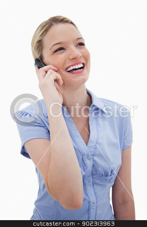 Laughing woman on the phone stock photo, Laughing woman on the phone against a white background by Wavebreak Media