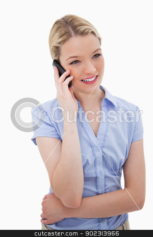 Young woman talking on the phone stock photo, Young woman talking on the phone against a white background by Wavebreak Media