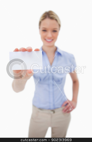 Blank business card being held by woman stock photo, Blank business card being held by woman against a white background by Wavebreak Media