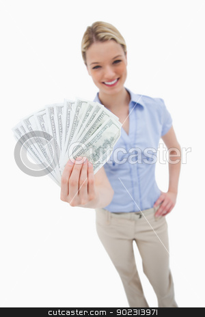 Money being held by woman stock photo, Money being held by woman against a white background by Wavebreak Media
