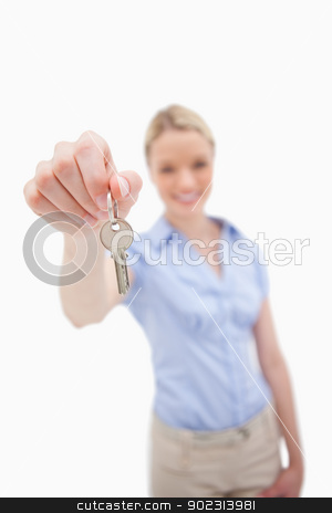 Key being handed over by woman stock photo, Key being handed over by woman against a white background by Wavebreak Media