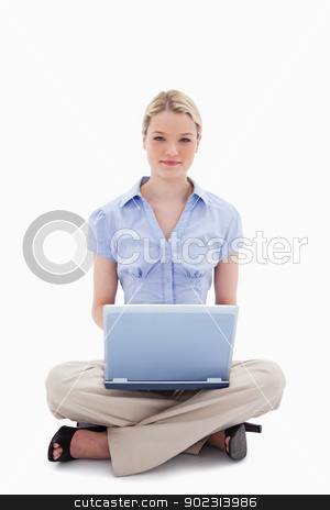 Woman sitting with her laptop stock photo, Woman sitting with her laptop against a white background by Wavebreak Media