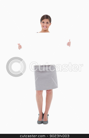 Woman holding blank sign stock photo, Woman holding blank sign against a white background by Wavebreak Media