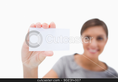 Blank business card being presented by woman stock photo, Blank business card being presented by woman against a white background by Wavebreak Media