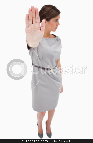 Woman signals stop stock photo, Woman signals stop against a white background by Wavebreak Media