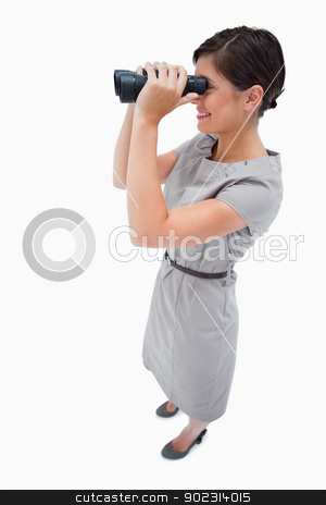 Side view of woman using spyglasses stock photo, Side view of woman using spyglasses against a white background by Wavebreak Media