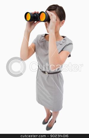 Woman using spyglasses stock photo, Woman using spyglasses against a white background by Wavebreak Media