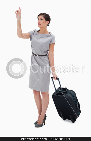 Woman with wheely bag calling a taxi stock photo, Woman with wheely bag calling a taxi against a white background by Wavebreak Media