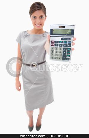 Woman showing hand calculator stock photo, Woman showing hand calculator against a white background by Wavebreak Media