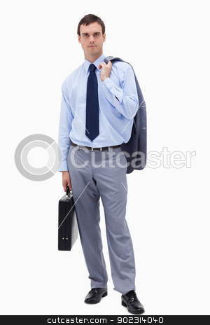 Businessman with suitcase stock photo, Businessman with suitcase against a white background by Wavebreak Media