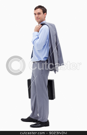 Side view of businessman with suitcase stock photo, Side view of businessman with suitcase against a white background by Wavebreak Media