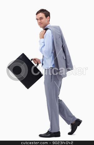 Side view of walking businessman with suitcase stock photo, Side view of walking businessman with suitcase against a white background by Wavebreak Media