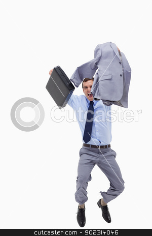 Happy businessman with suitcase jumping stock photo, Happy businessman with suitcase jumping against a white background by Wavebreak Media
