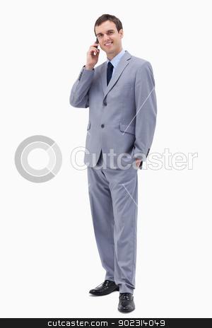 Smiling businessman on the phone stock photo, Smiling businessman on the phone against a white background by Wavebreak Media