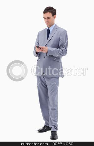 Businessman writing text message stock photo, Businessman writing text message against a white background by Wavebreak Media