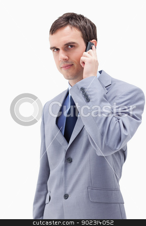 Businessman on the cellphone stock photo, Businessman on the cellphone against a white background by Wavebreak Media
