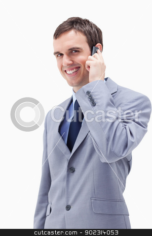 Smiling businessman on the cellphone stock photo, Smiling businessman on the cellphone against a white background by Wavebreak Media