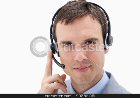 Businessman with headset stock photo, Businessman with headset against a white background by Wavebreak Media