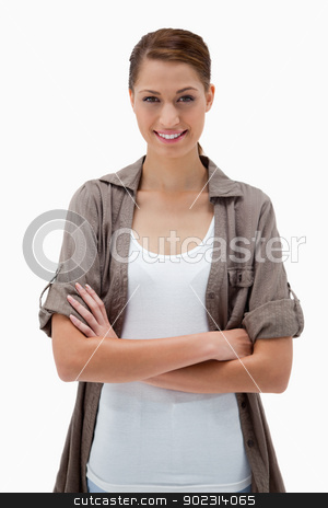 Smiling woman with arms folded stock photo, Smiling woman with arms folded against a white background by Wavebreak Media