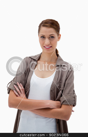 Smiling woman standing with folded arms stock photo, Smiling woman standing with folded arms against a white background by Wavebreak Media