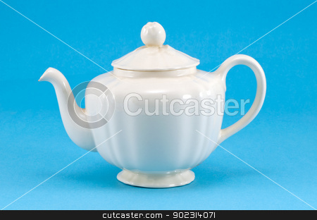 retro ceramic white teapot dish on blue background  stock photo, retro ceramic white teapot dish on blue background.  by sauletas