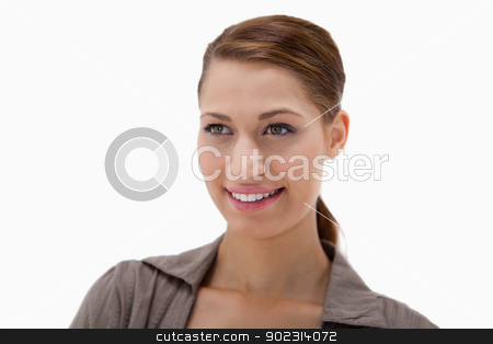 Beautiful smiling young woman stock photo, Beautiful smiling young woman against a white background by Wavebreak Media