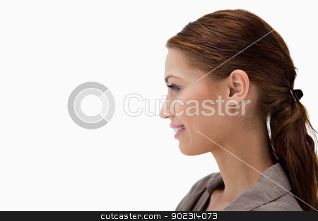 Side view of young woman stock photo, Side view of young woman against a white background by Wavebreak Media