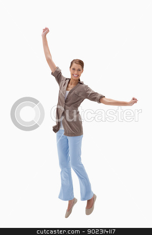 Happy woman jumping stock photo, Happy woman jumping against a white background by Wavebreak Media