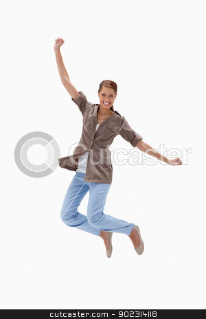 Smiling woman jumping stock photo, Smiling woman jumping against a white background by Wavebreak Media