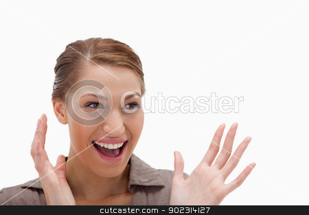 Cheerful excited woman stock photo, Cheerful excited woman against a white background by Wavebreak Media
